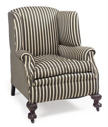 A WALNUT WINGBACK ARMCHAIR