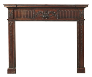 AN IRISH WALNUT CHIMNEYPIECE
