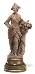 A FRENCH TERRACOTTA FEMALE FIG