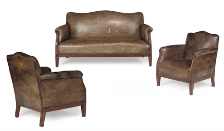A WALNUT AND LEATHER UPHOLSTER
