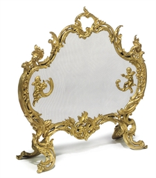 A GILT BRONZE FIRESCREEN