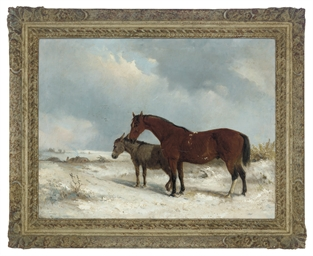A horse and foal in a winter l
