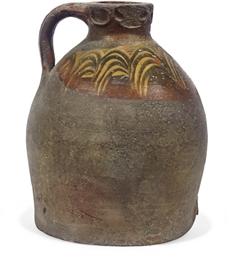 A MEDIEVAL SLIP-DECORATED WINE