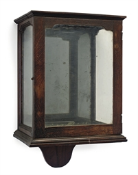 A GEORGE III OAK WALL LANTERN
