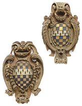TWO ENGLISH GILTWOOD AND POLYCHROME ARMORIAL SHIELDS