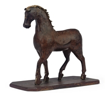 A BROWN PAINTED TOY HORSE