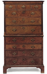 A GEORGE II FIGURED WALNUT AND