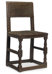 A CHARLES II OAK AND LEATHER-U