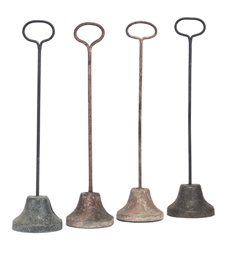 FOUR IRON AND LEAD DOOR STOPS