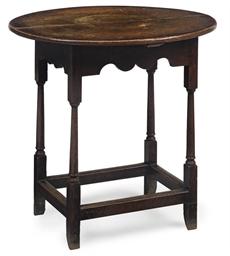 A GEORGE II OAK OVAL TABLE