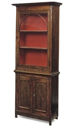 AN EARLY VICTORIAN OAK CABINET