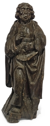 AN ENGLISH CARVED OAK FIGURE O