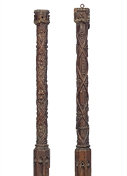 A PAIR OF HENRY VIII OAK POSTS