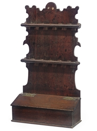 A GEORGE III OAK SPOON RACK