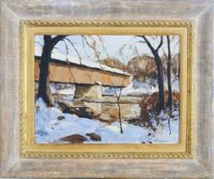 A snow covered bridge over a f