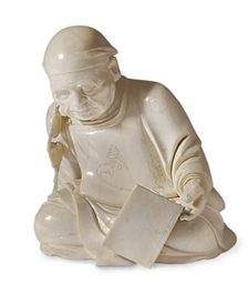 A JAPANESE IVORY FIGURE OF A D