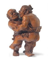 A JAPANESE CARVED WOOD FIGURE