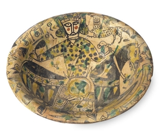 A NISHAPUR POTTERY BOWL DECORA