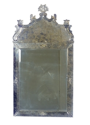 AN ETCHED GLASS MIRROR,