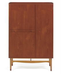 A WALNUT AND BEECH CABINET,