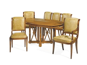 AN OAK DINING TABLE AND SET OF