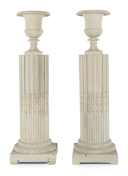 A PAIR OF URNS ON PEDESTALS,