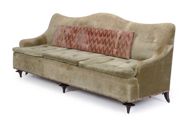 A GREEN UPHOLSTERED SOFA,
