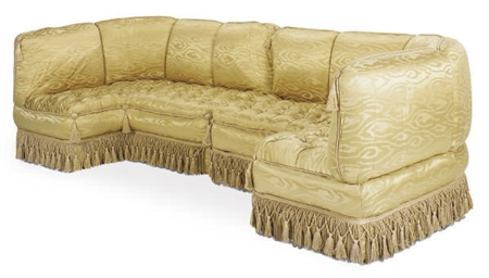 A GOLD SILK UPHOLSTERED SECTIO