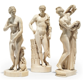 A SET OF THREE CARVED IVORY FI