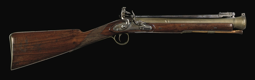 A FLINTLOCK BLUNDERBUSS SIGNED