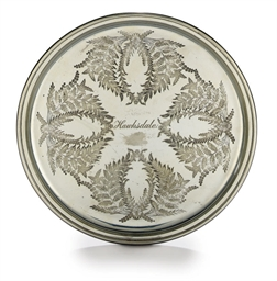 A circular serving tray in pla