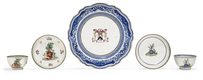 TWO ARMORIAL CUPS AND SAUCERS