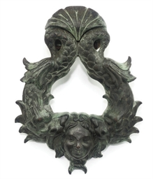 A VICTORIAN BRONZE DOOR KNOCKE