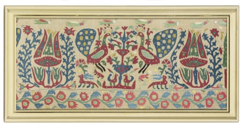 AN EMBROIDERED BORDER FRAGMENT