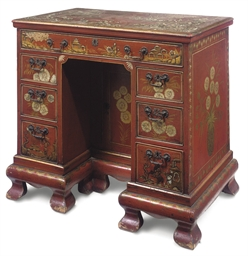 A RED JAPANNED KNEE-HOLE DESK