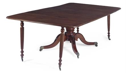 A REGENCY MAHOGANY DINING TABL