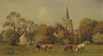 Cattle grazing, a village church beyond