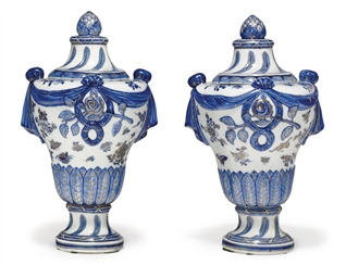 A PAIR OF BLUE AND WHITE URNS