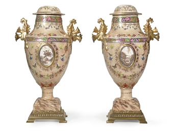 A PAIR OF PEACH-GROUND URNS AN