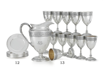 A SET OF TWELVE SILVER BREAD PLATES
