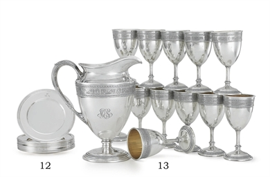 A SET OF TWELVE SILVER BREAD P