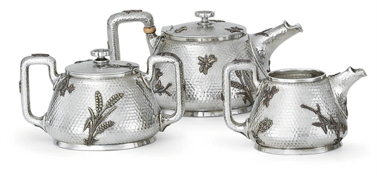 A THREE-PIECE SILVER AND MIXED