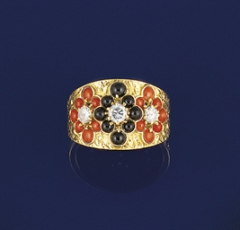 A diamond, onyx and coral ring