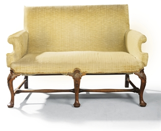 A GEORGE II WALNUT SOFA