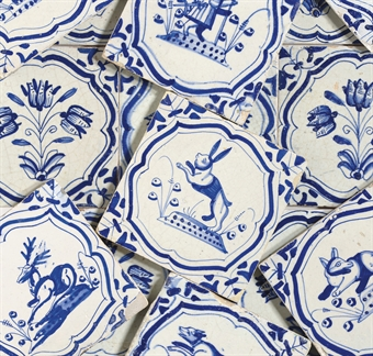 A SET OF FOURTEEN DUTCH DELFT ANIMAL TILES AND A SET OF NINE DUTCH DELFT TULIP TILES