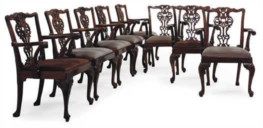 A SET OF EIGHT WALNUT DINING C