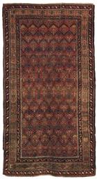 An antique Feraghan rug & Kara