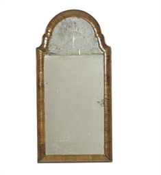 A NORTH EUROPEAN WALNUT MIRROR