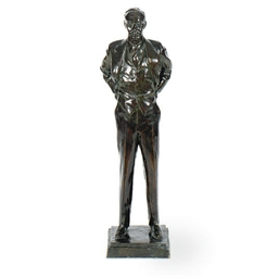 A PATINATED BRONZE FIGURE OF F