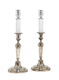 A PAIR OF SILVERED-METAL CANDL